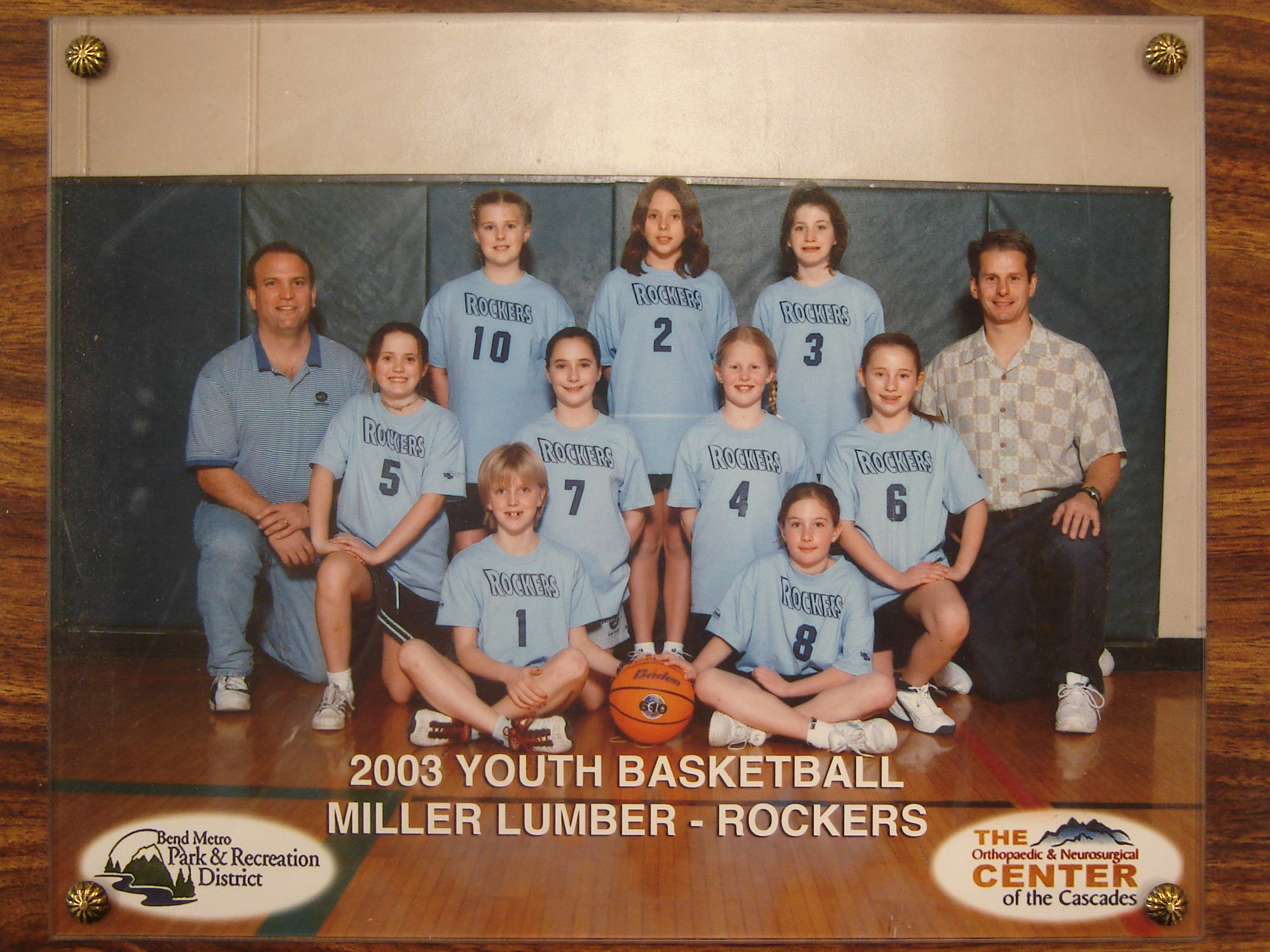 Not only did Miller Lumber sponsor this 2003 girls' basketball team, but President Charley Miller coached as well.